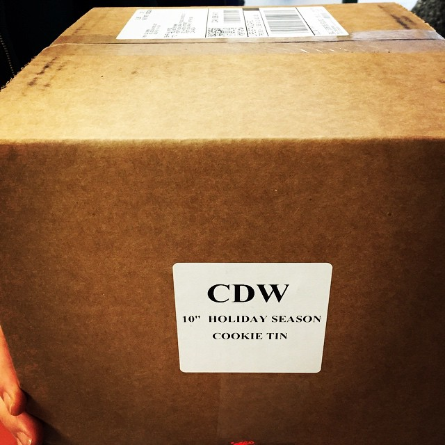 CDW 10″ holiday cookie tin.  Made of Aluminum.