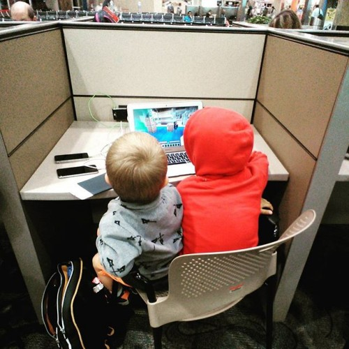 """Business Travellers"" at the airport workstation."