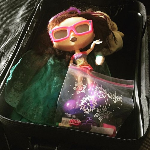 Carmen, packing the important stuff for her trip.