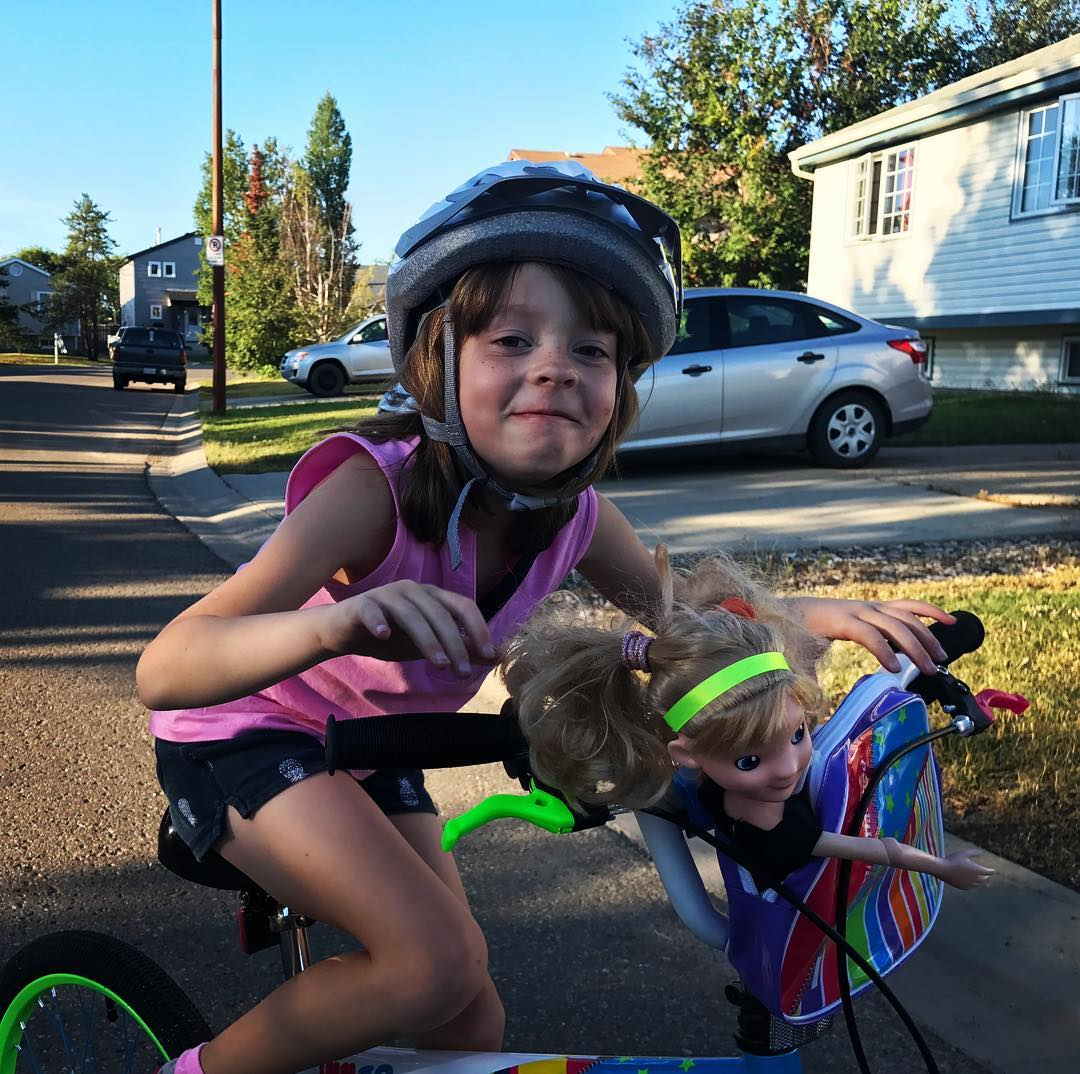 "Carmen brings dolls along for ""bike practice."""