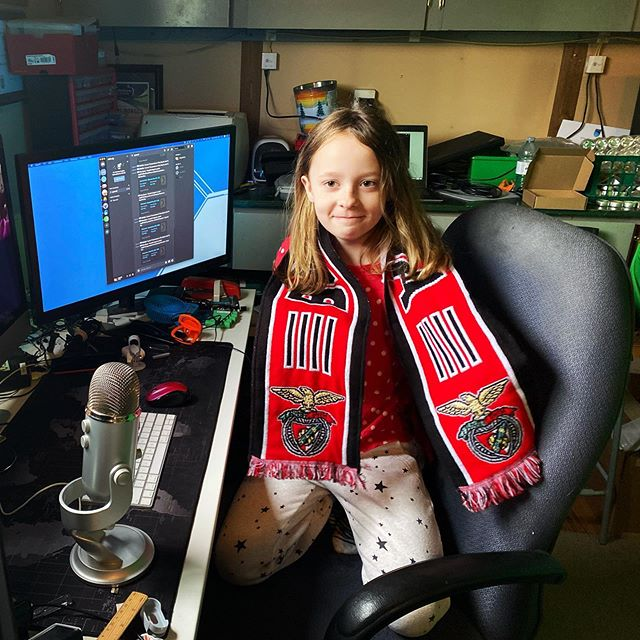 Carmen wearing her Benfica scarf for her online class today.