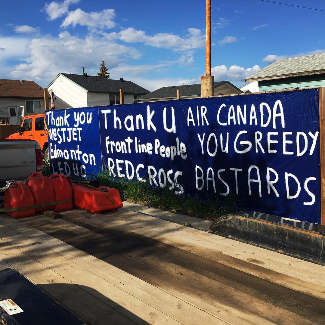 """Thank you Westjet. Air Canada you greedy bastards."" Sign in #ymm @westjet @aircanada"