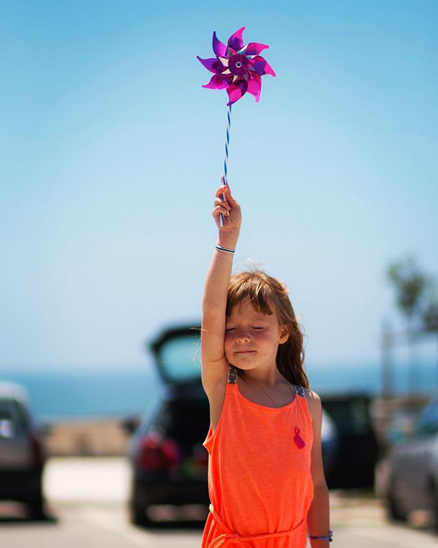 4 years ago, June 2016.  Carmen's reaction to the Atlantic breeze in Praia de Mira, Portugal.