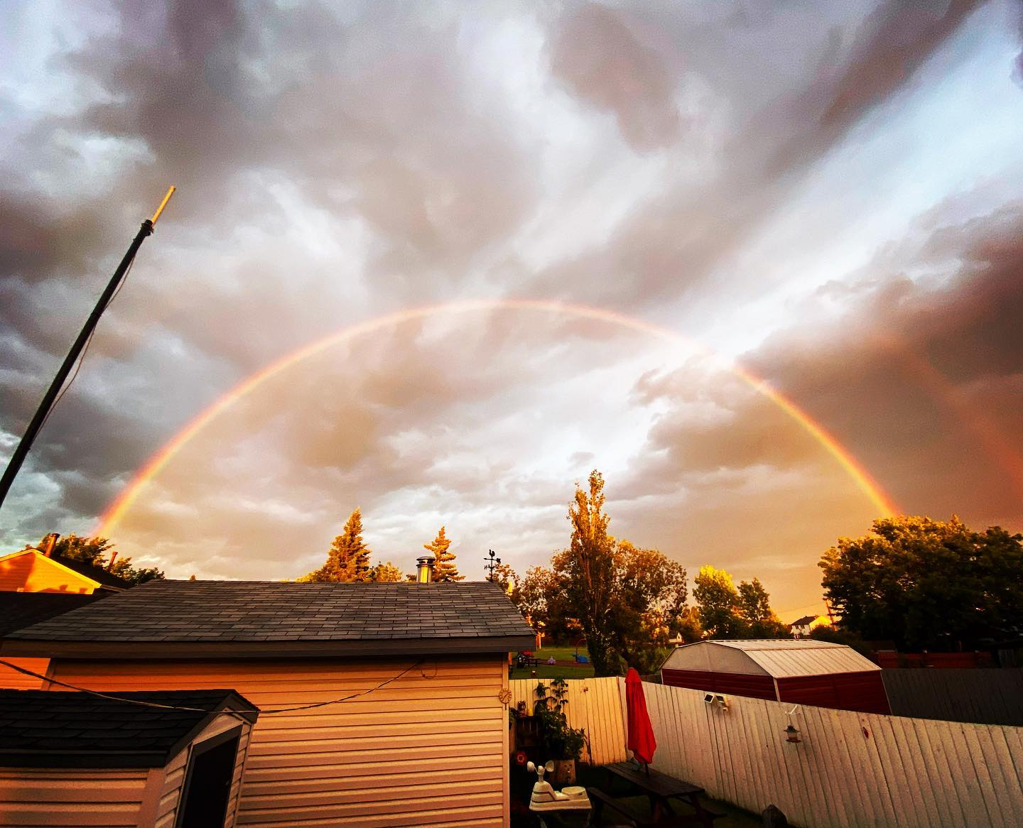 Full double rainbow in my backyard a couple of nights ago.