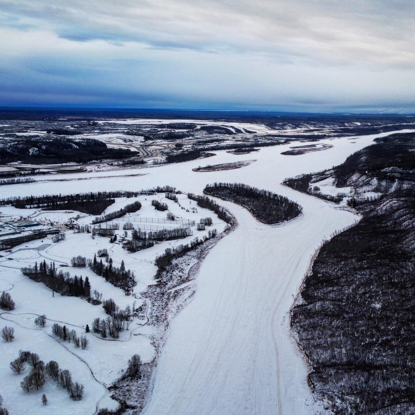 In between the snow and rain today, I managed to snap this drone photo from Snye Point, looking North towards the Athabaskan River.  #ymm #mavic